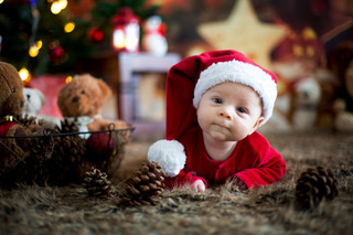 A baby in a Christmas hat