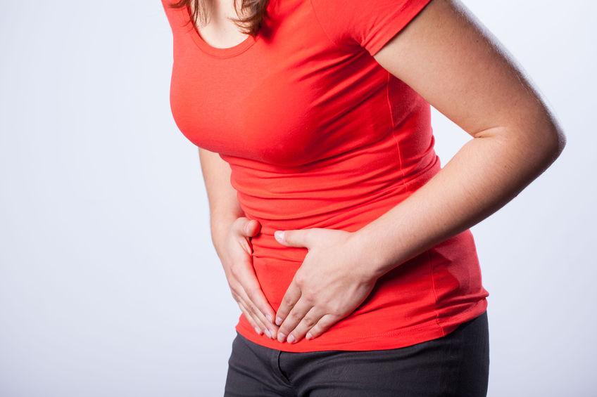 A woman suffering pelvic pain.